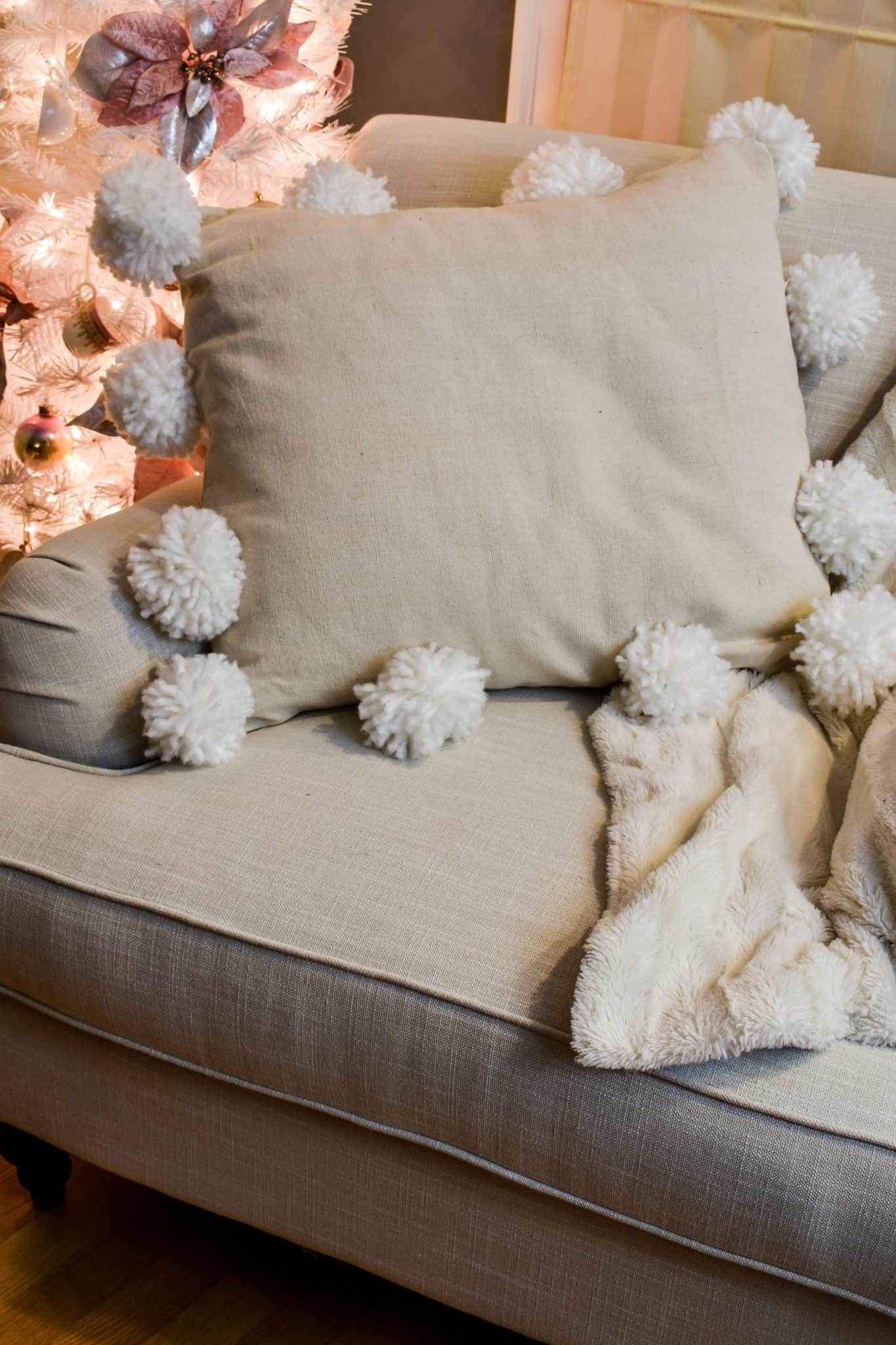 tuesday turn about winter diy projects pom-pom pillow on sofa