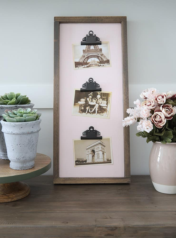 diy wood clipboard with photos on console with plants and flowers