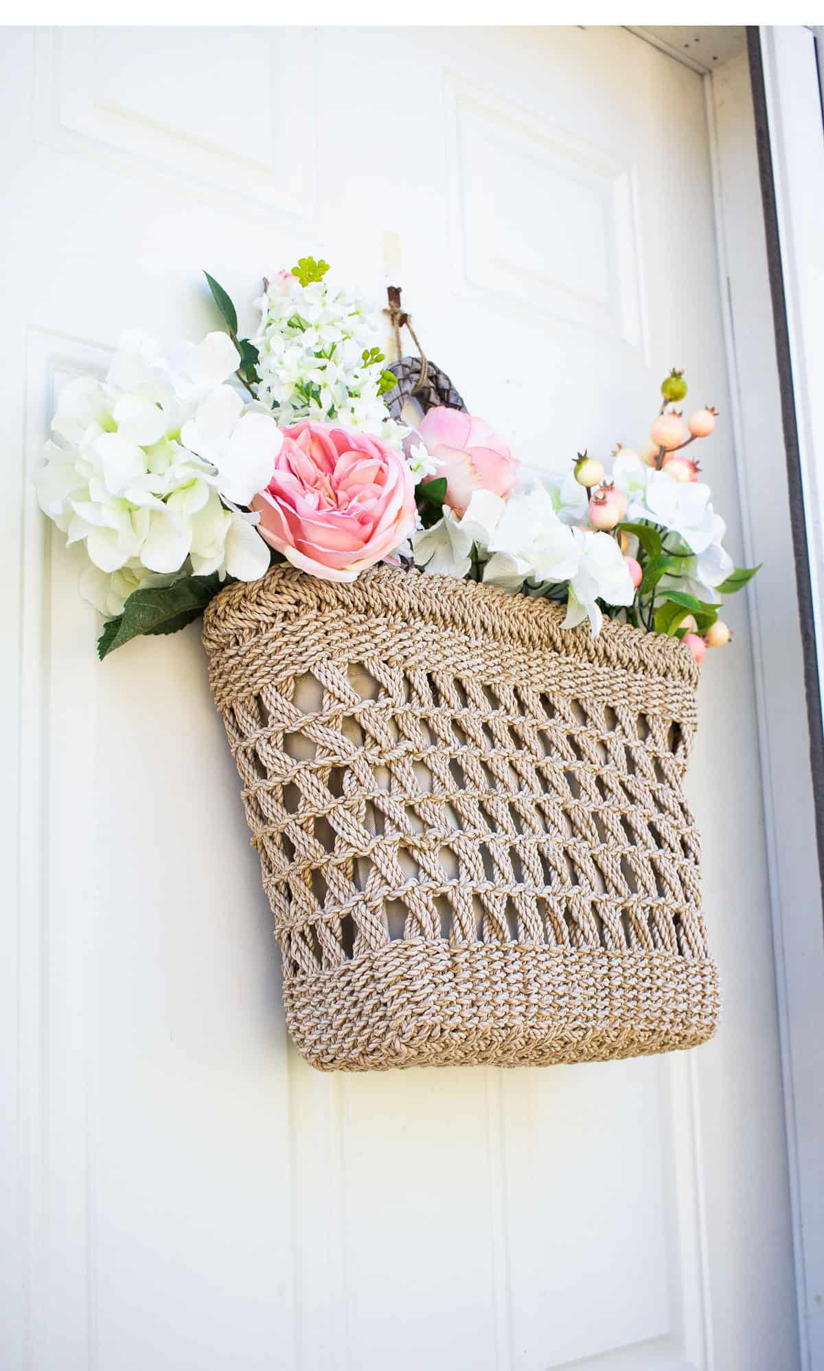 small spring porch tote wreath with spring flowers on door
