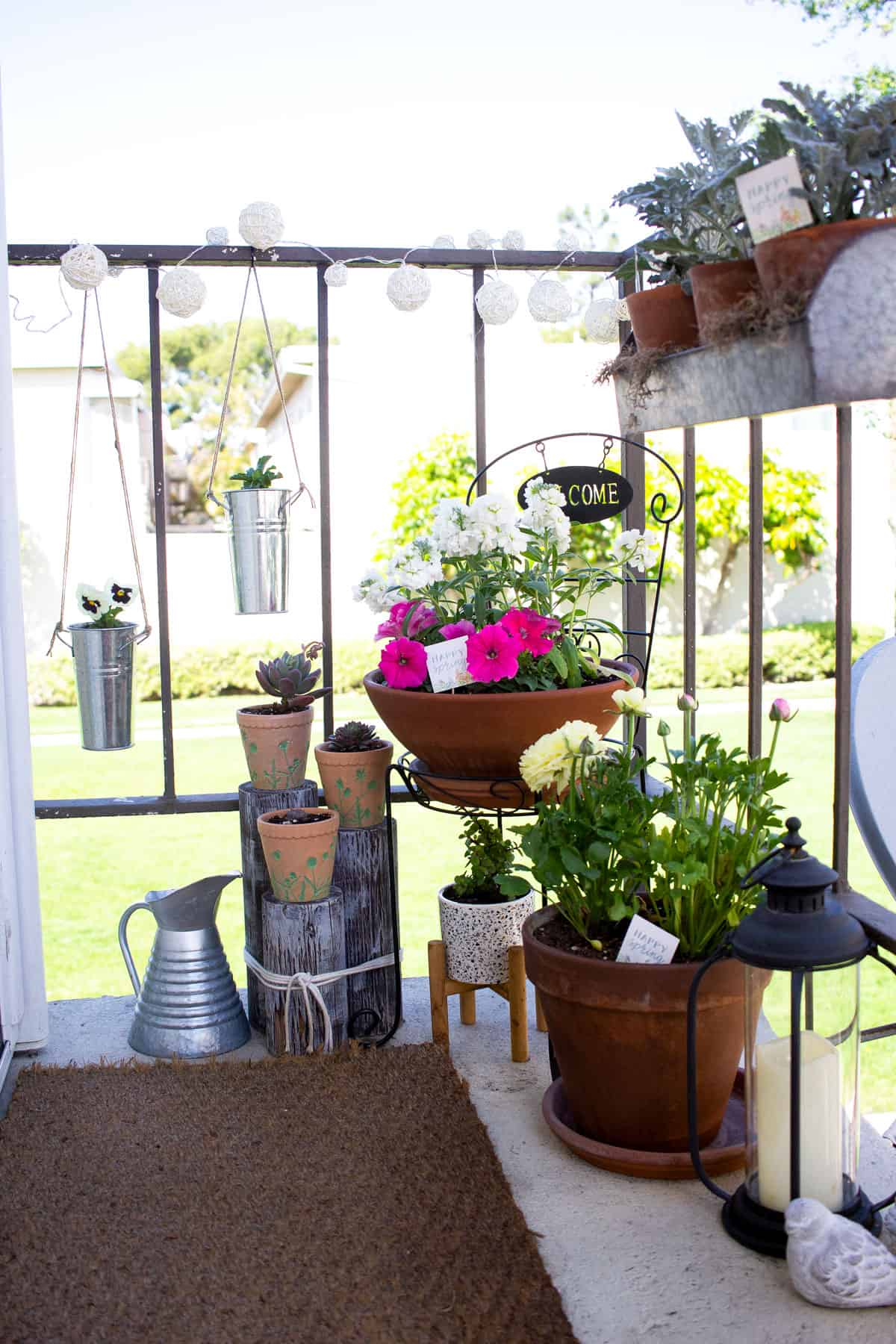 small spring porch with pots and flowers