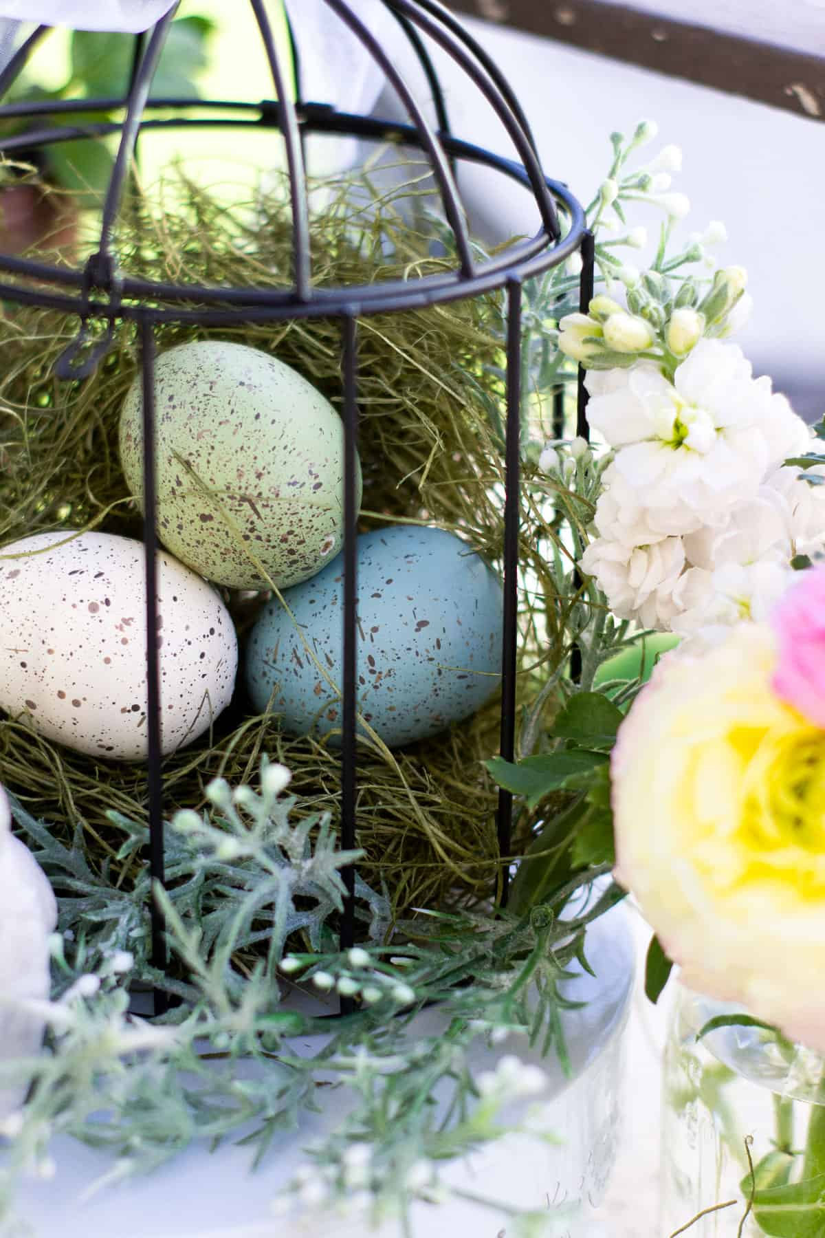 spring bird cage pinterest challenge vignette with bird cage and spring elements