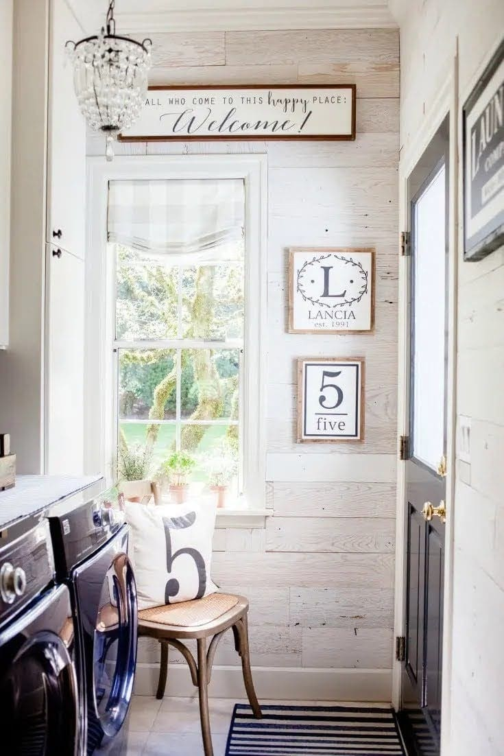 farmhouse style laundry room with wood covered walls