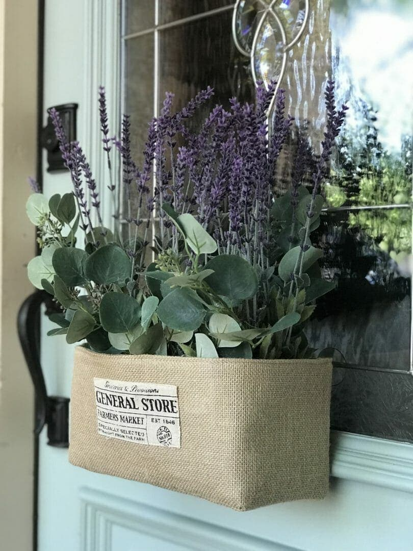 burlap window box with lavender and greenery on door