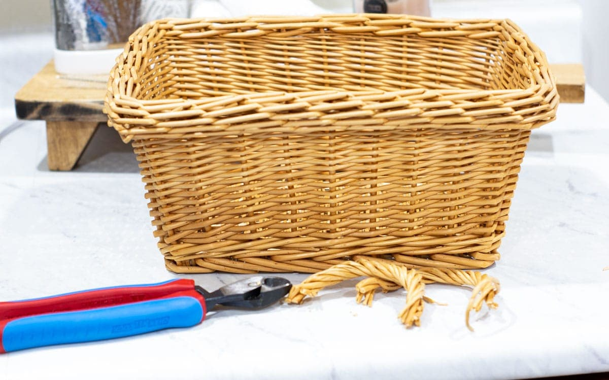 woven basket with handles removed and wire cutters on counter