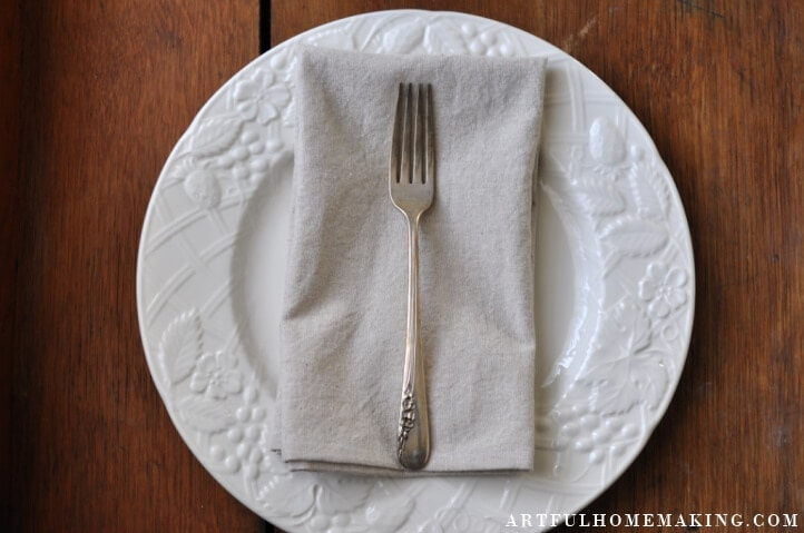 tuesday turn about 100 celebrate white plate on wooden surface with linen napkin and fork
