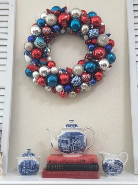 red white and blue ornament wreath above mantel