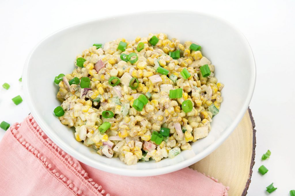 white bowl with corn and veggie dip