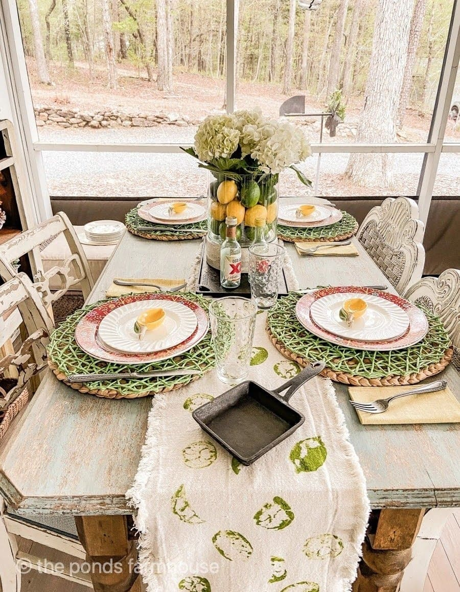 tuesday turn about 98 celebrate may fiesta tablescape with yellow and green plates and accents