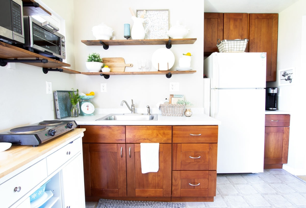 apartment summer decor tips kitchen cabinets and fridge with open shelving