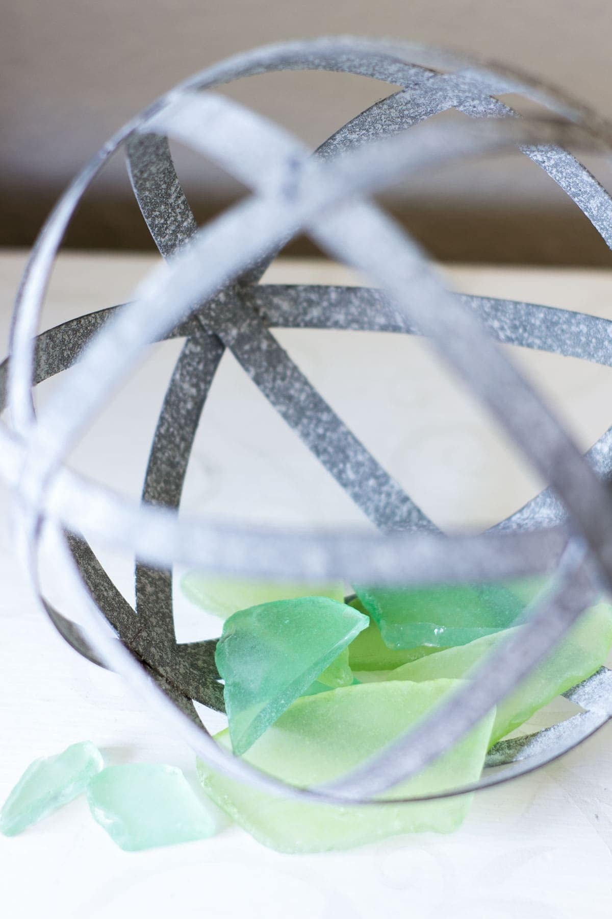 metal orb with sea glass pieces