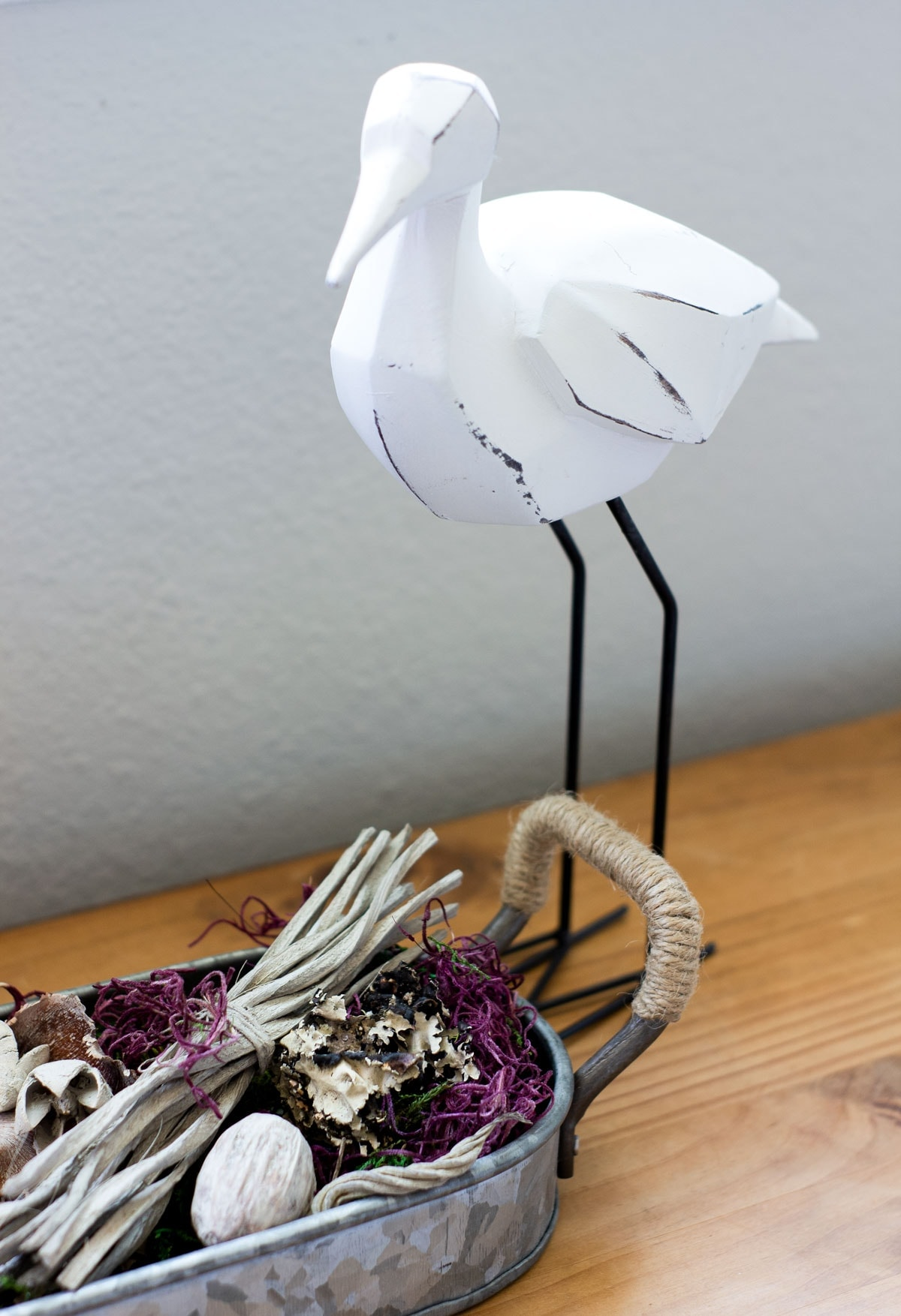 wooden sandpiper with natural elements on wood surface