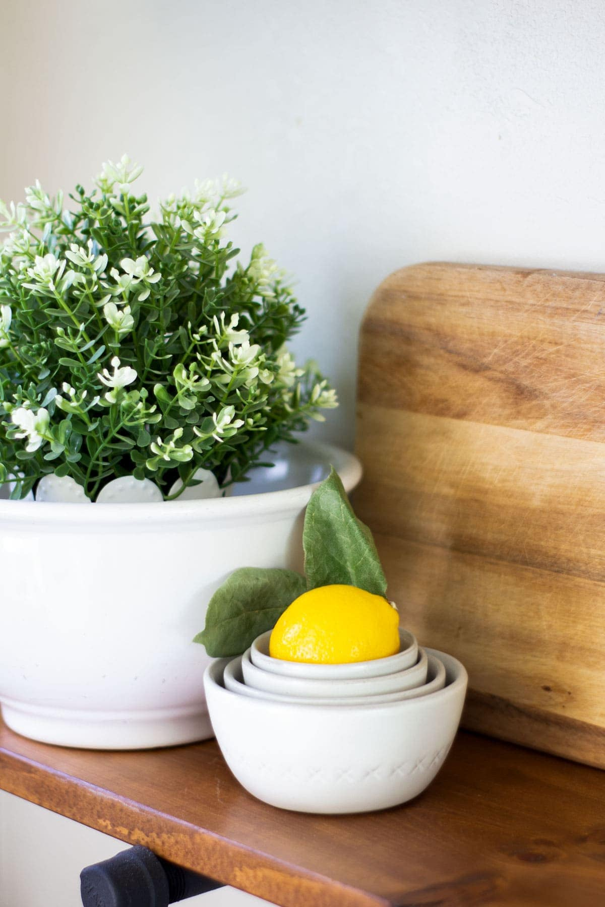 ironstone bowls with greener and lemons with bread board