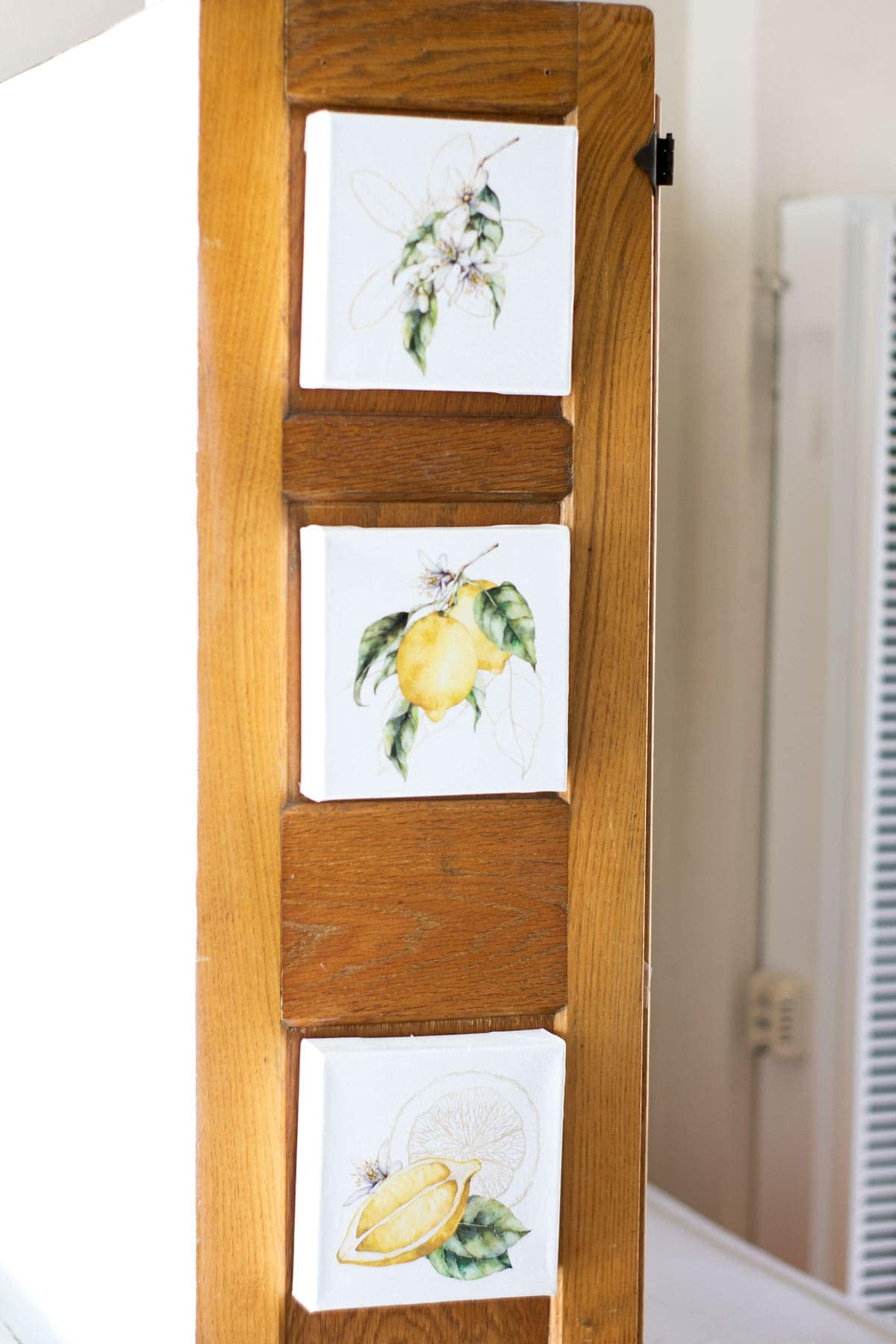 apartment summer decor tips lemon printables on canvas on side of bakers cabinet
