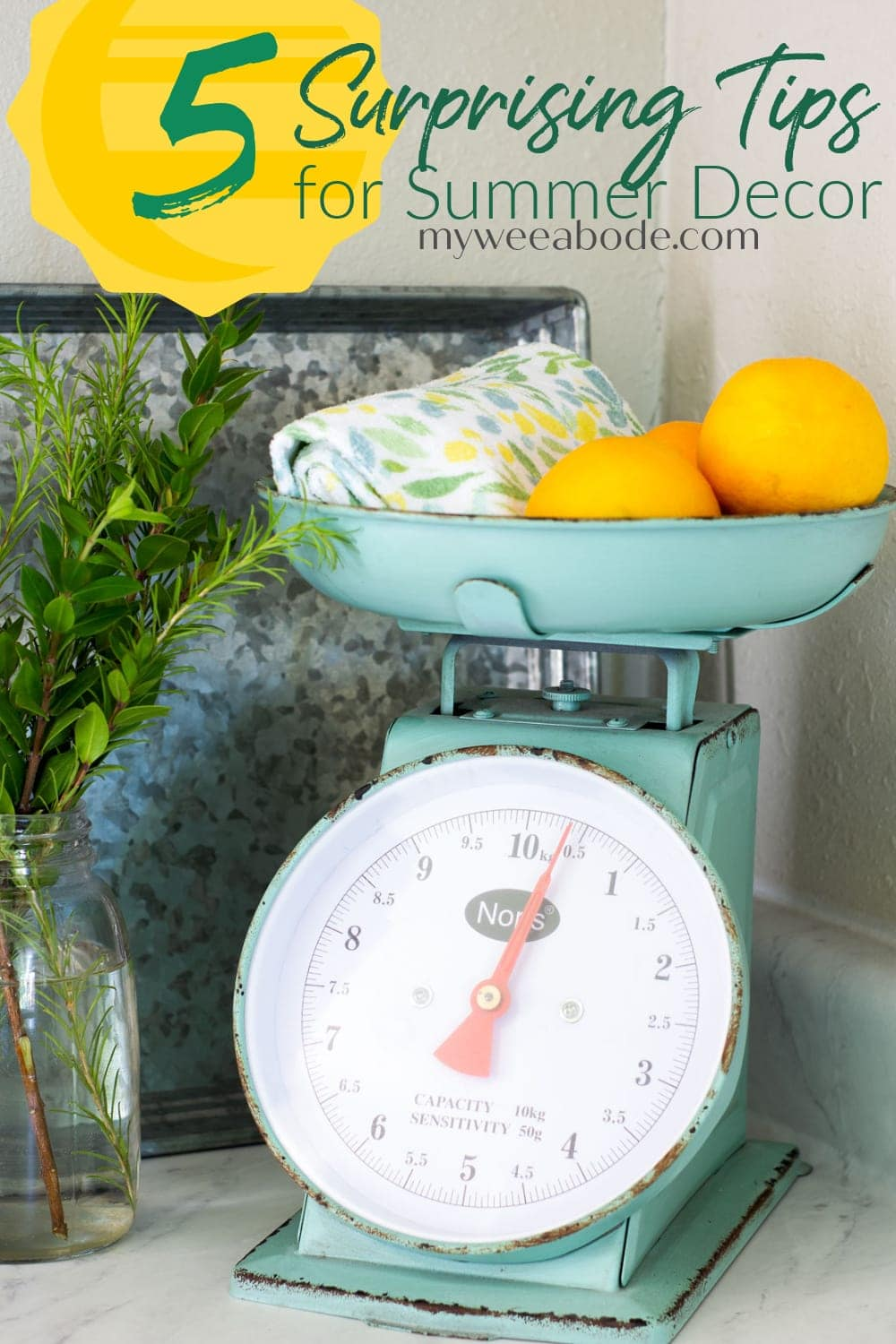 apartment summer decor tips green scale with lemons and vase with greenery on marble counter