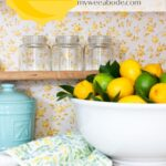 apartment summer decor tips lemons and limes in ironstone bowl