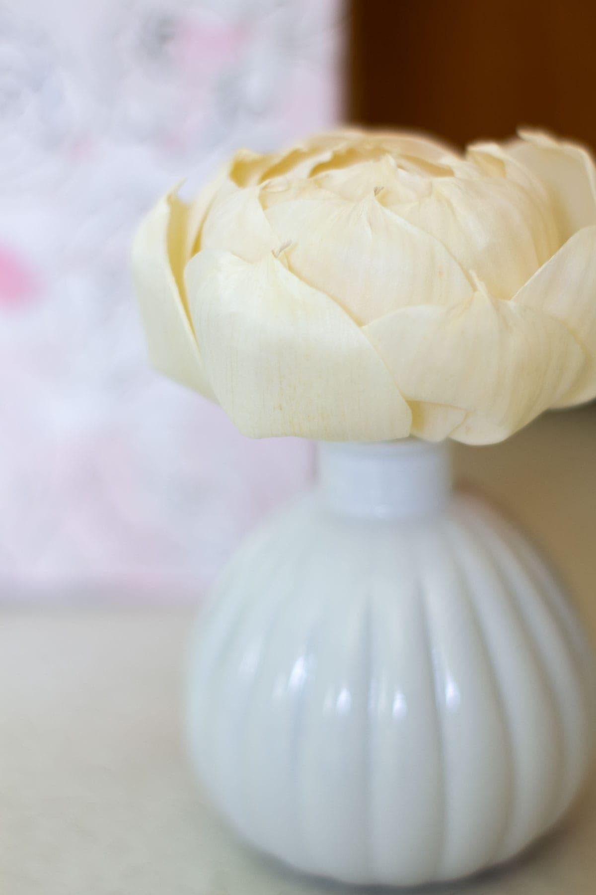 find your signature scent white jar with ivory paper flower