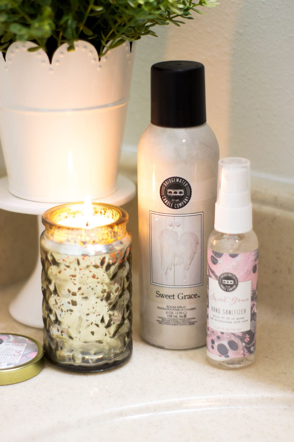 find your signature scent with mercury glass candle with flame and room deodorizer and sanitizer