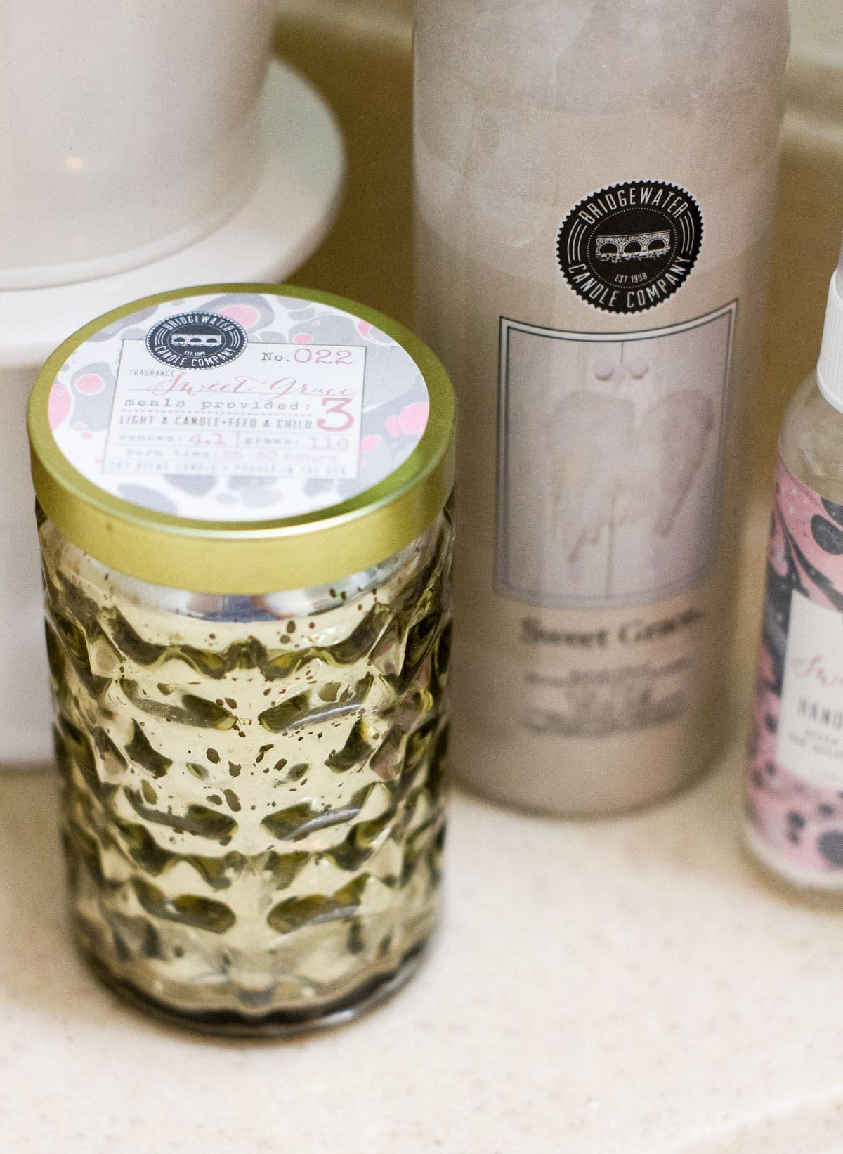 find your signature scent mercury glass candle with room spray on counter