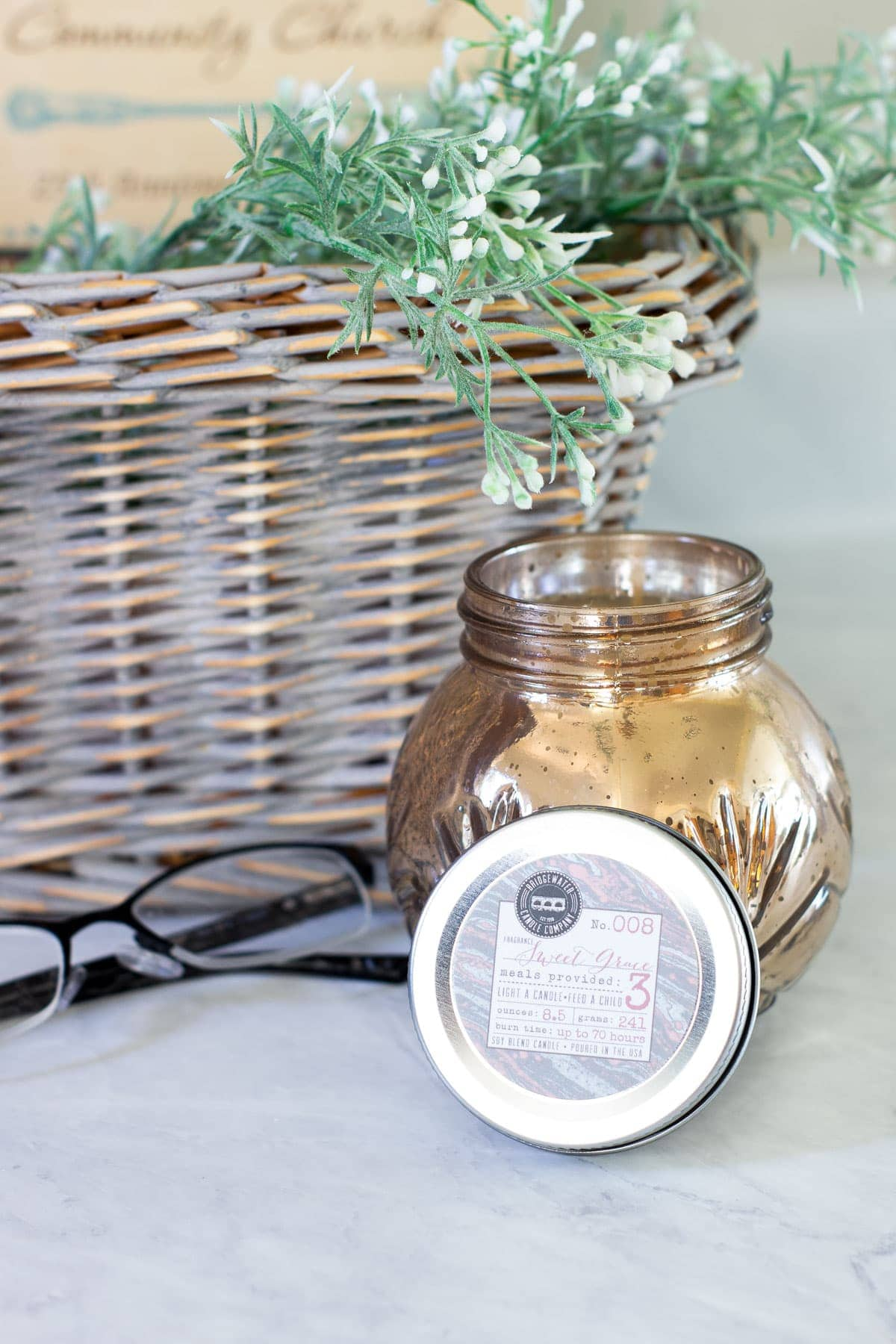 find your signature scent mercury glass candle with basket on counter with glasses