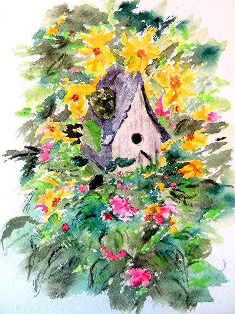 watercolor painting of bird house and surrounded by flowers