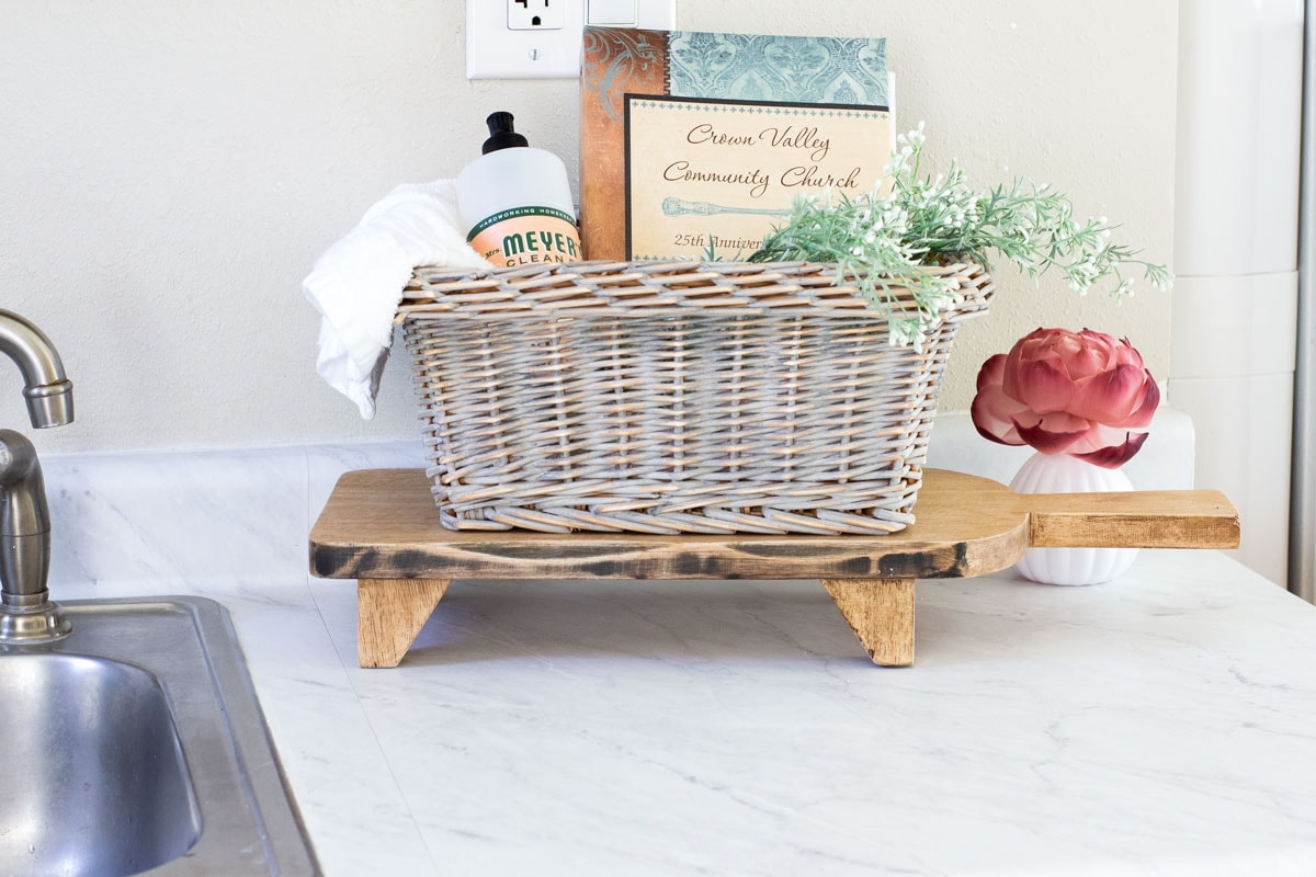 kitchen counter with faux marble contact paper and basket with kitchen items