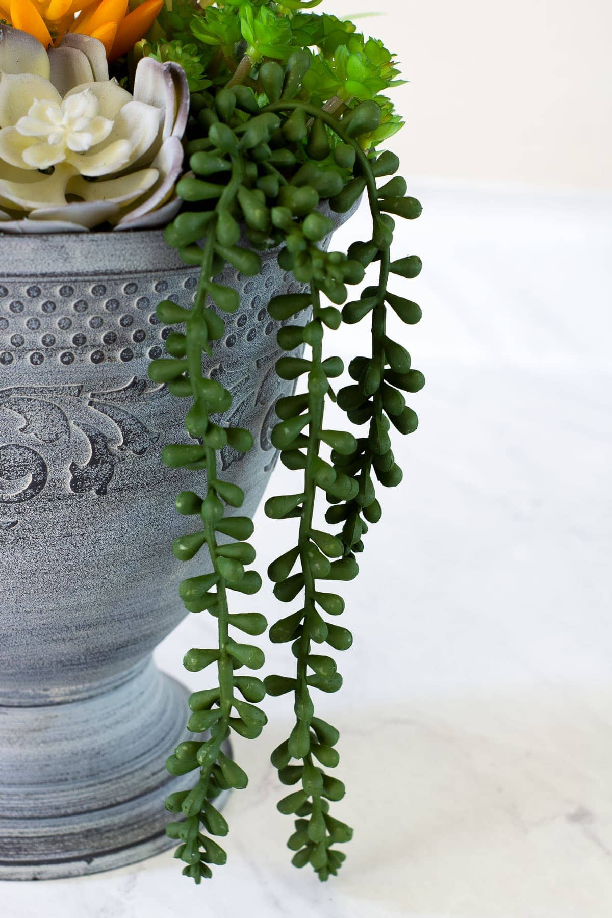 diy faux mini succulent arrangement closeup of tendrals