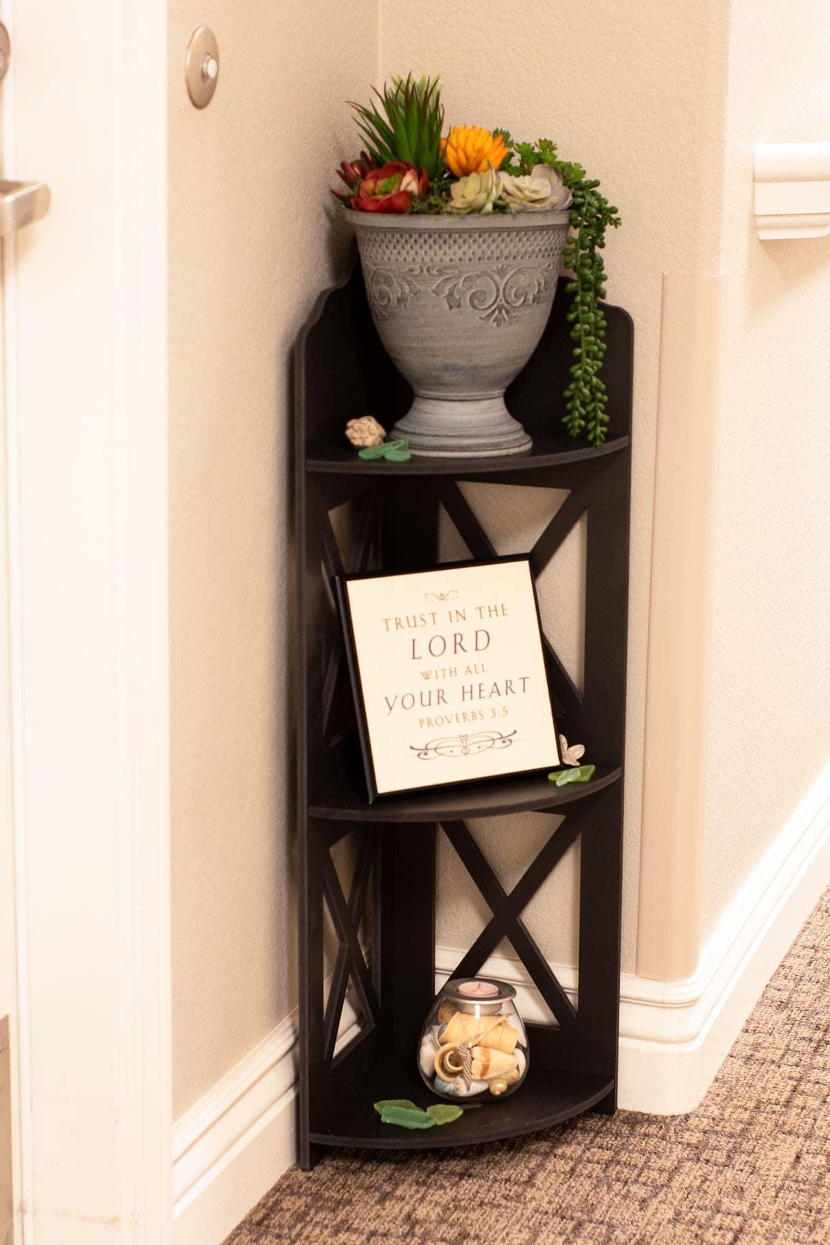 corner shelf unit outside apartment door