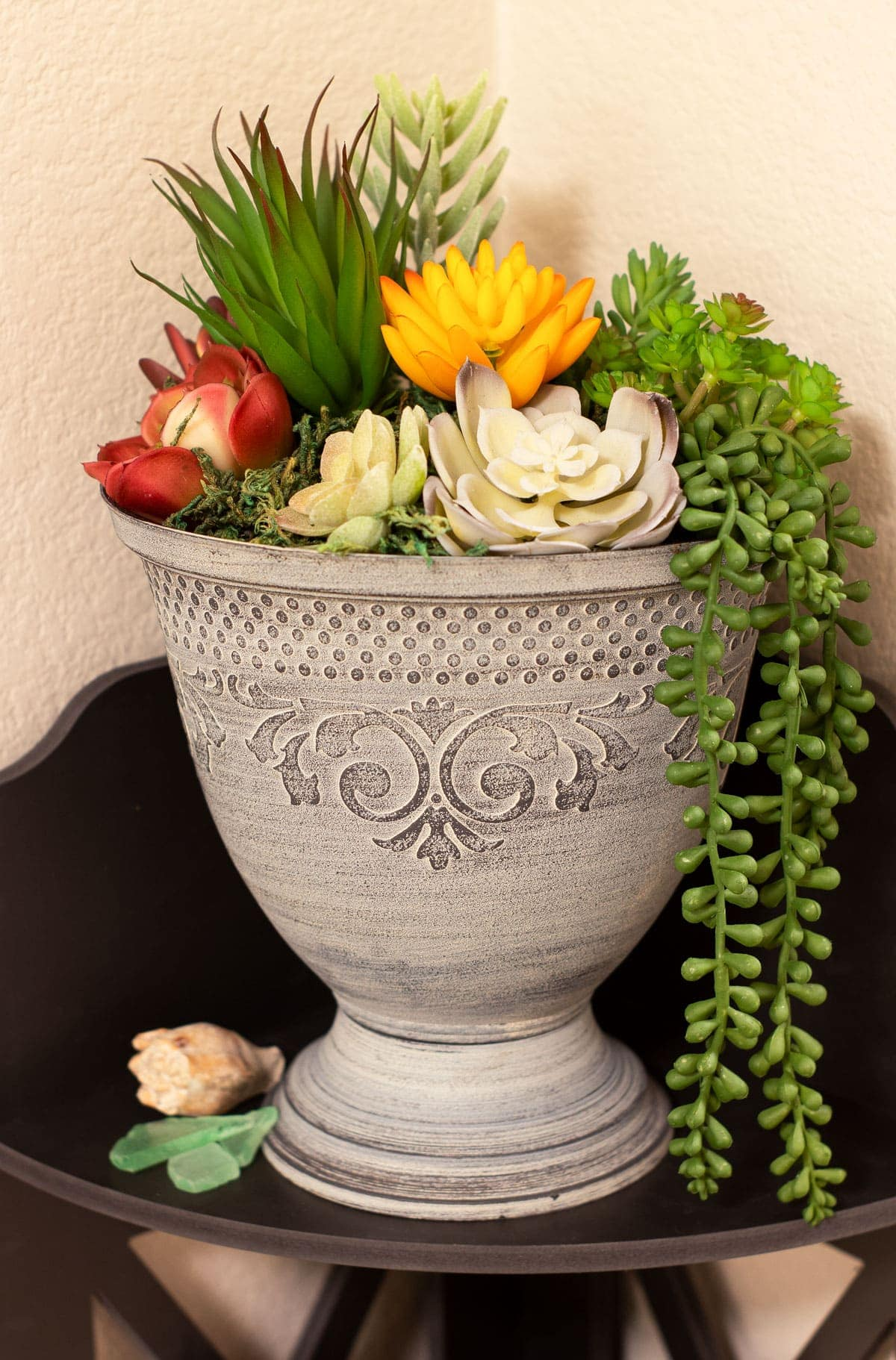 diy faux mini succulent arrangement on dark shelf