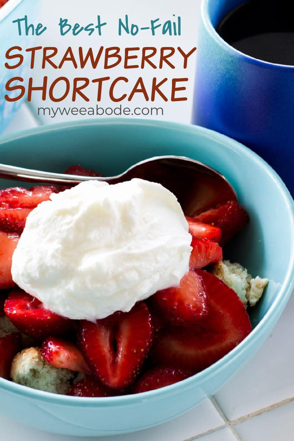 easy no fail strawberry shortcake in aqua bowl on tile counter with blue coffee cup