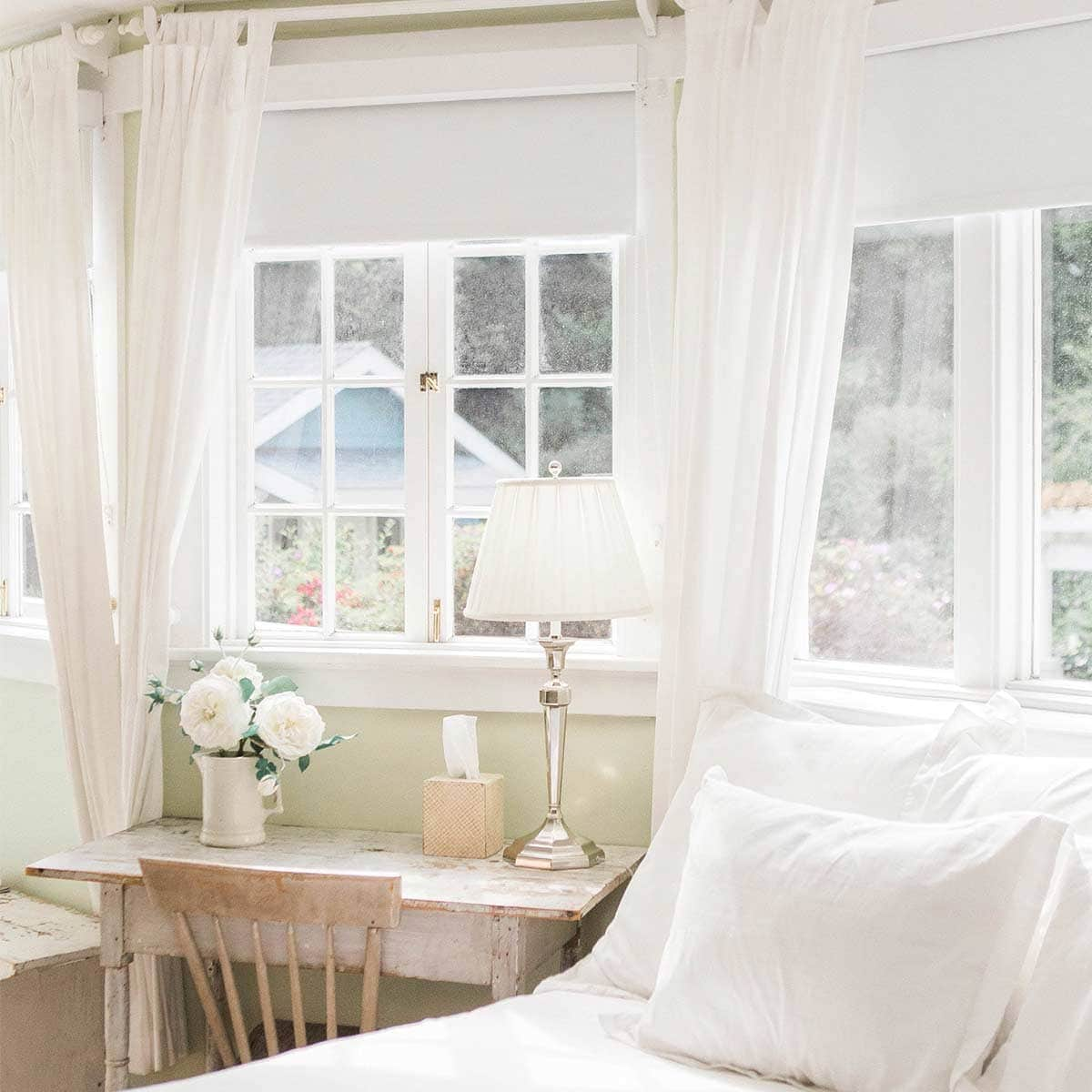 white bedroom with cottage details