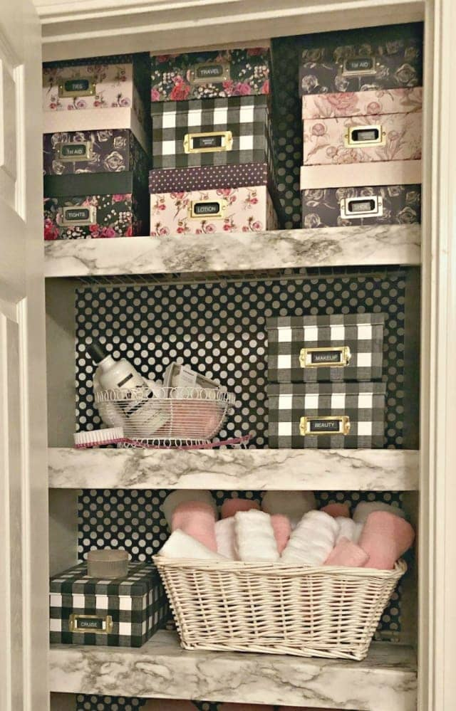 shelves with boxes and linens