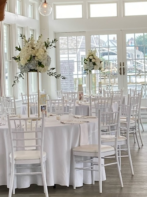summer wedding reception with white and blue florals and white accents