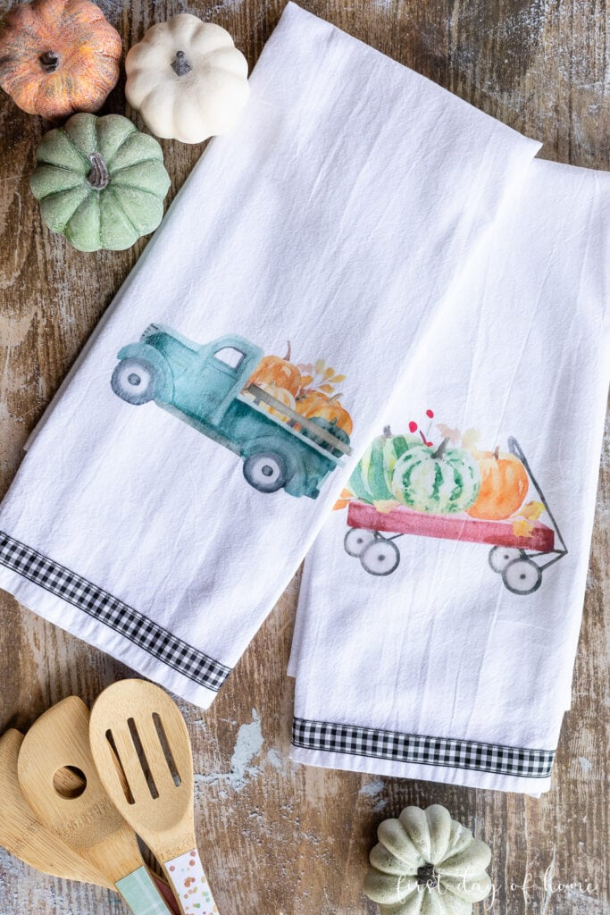tuesday turn about 118 more fall fun tea towels with fall elements on wood surface