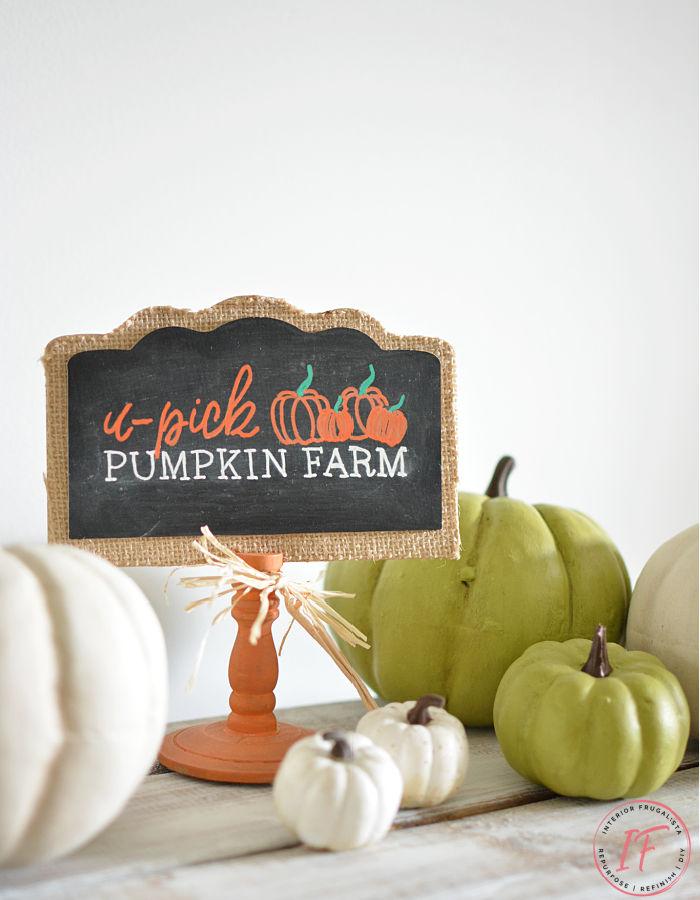 mini pumpkin chalkboard sign with pumpkins on table