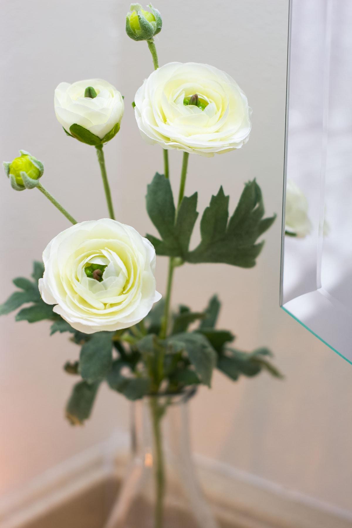 modern coastal bathroom makeover reveal closeup of flowers