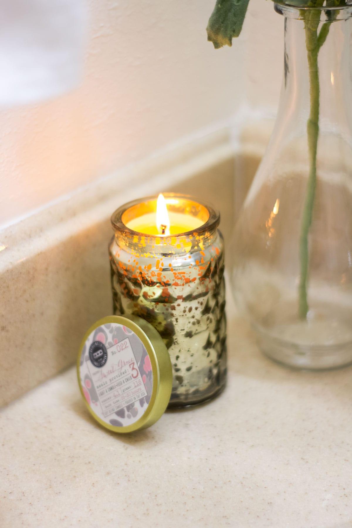 mercury glass candle on bathroom counter