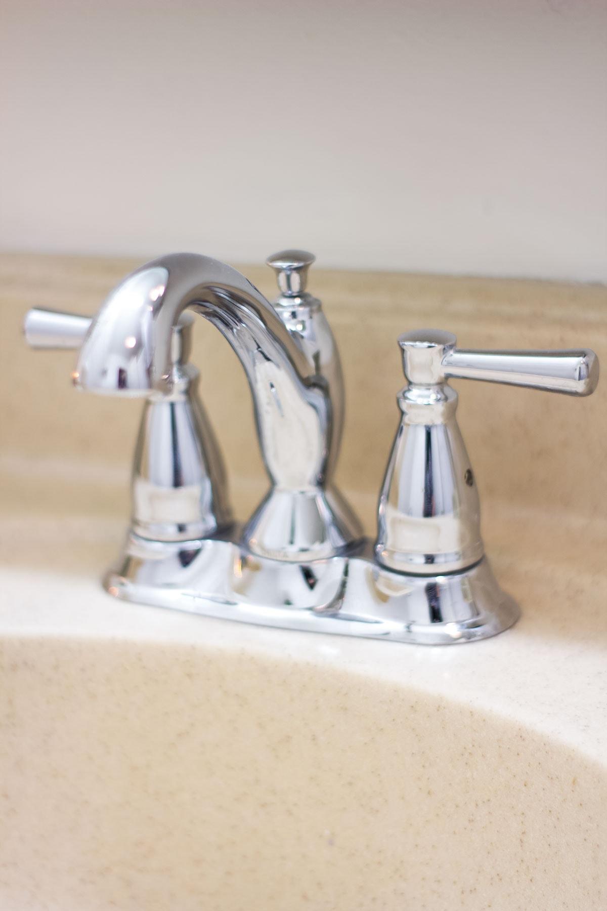 modern coastal bathroom makeover reveal chrome faucet