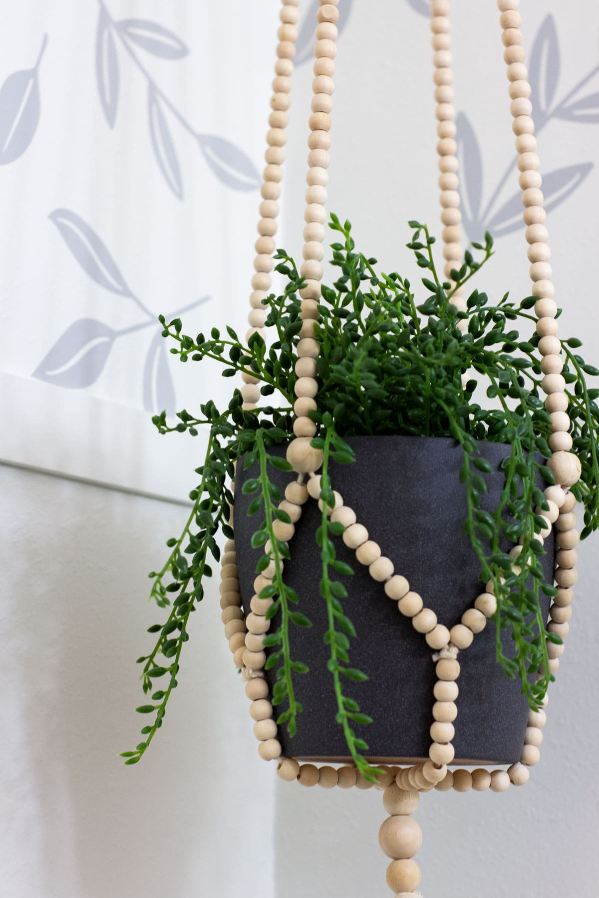 modern coastal bathroom makeover reveal bathroom hanging planter with beaded holder