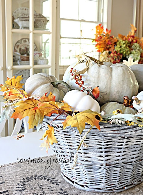 tuesday turn about 121 table tidbits centerpiece with basket and pumpkins and florals